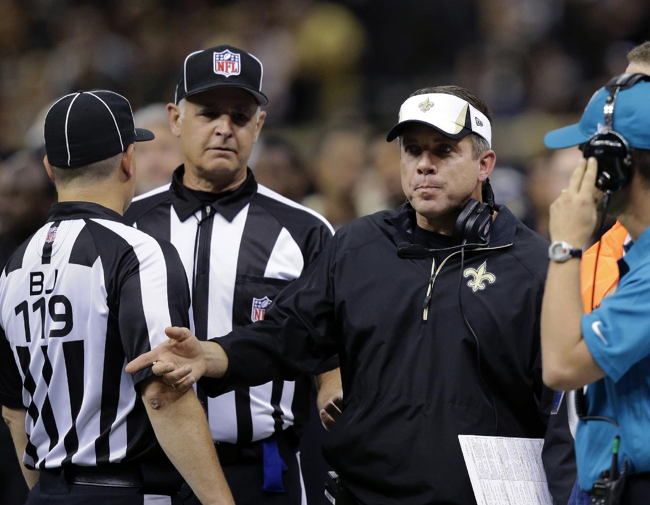 New Orleans Saints head coach Sean Payton challenges the officials in the first half of an NFL football game against the San Francisco 49ers in New Orleans, Sunday, Nov. 17, 2013