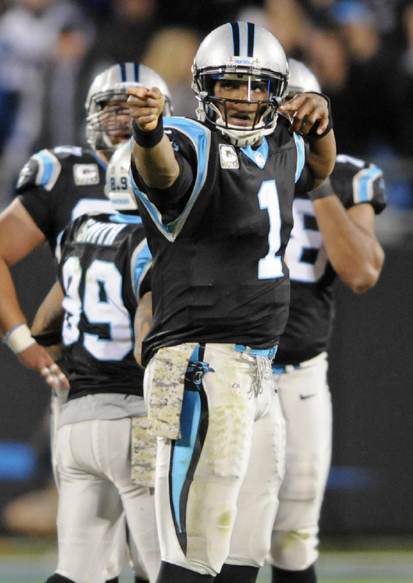 Carolina Panthers' Cam Newton (1) celebrates after a first down against the New England Patriots during the second half of an NFL football game in Charlotte, N.C., Monday, Nov. 18, 2013