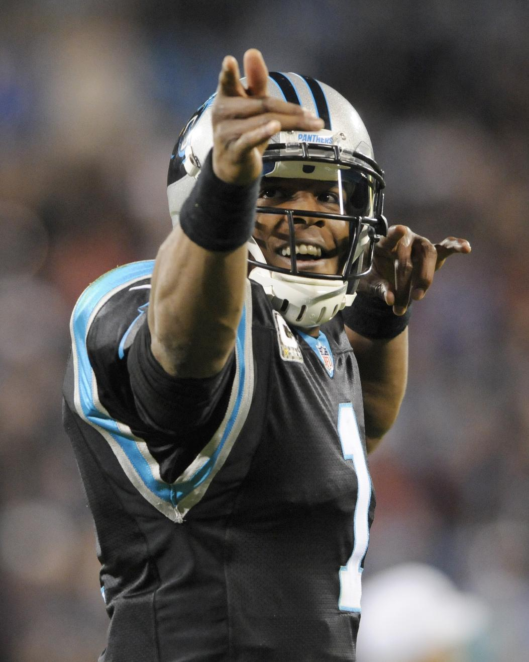 Carolina Panthers' Cam Newton (1) reacts after making a first down against the New England Patriots during the first half of an NFL football game in Charlotte, N.C., Monday, Nov. 18, 2013