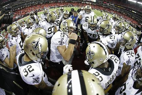 New Orleans Saints quarterback Drew Brees (9) cheers with the team before the first half of an NFL football game against the Atlanta Falcons, Thursday, Nov. 21, 2013, in Atlanta