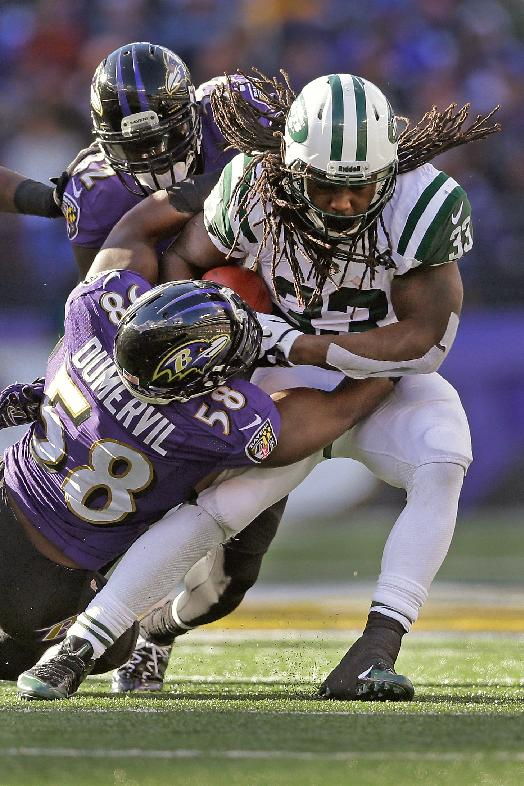New York Jets running back Chris Ivory, right, is tackled by Baltimore Ravens outside linebacker Elvis Dumervil during the first half of an NFL football game in Baltimore, Md., Sunday, Nov. 24, 2013