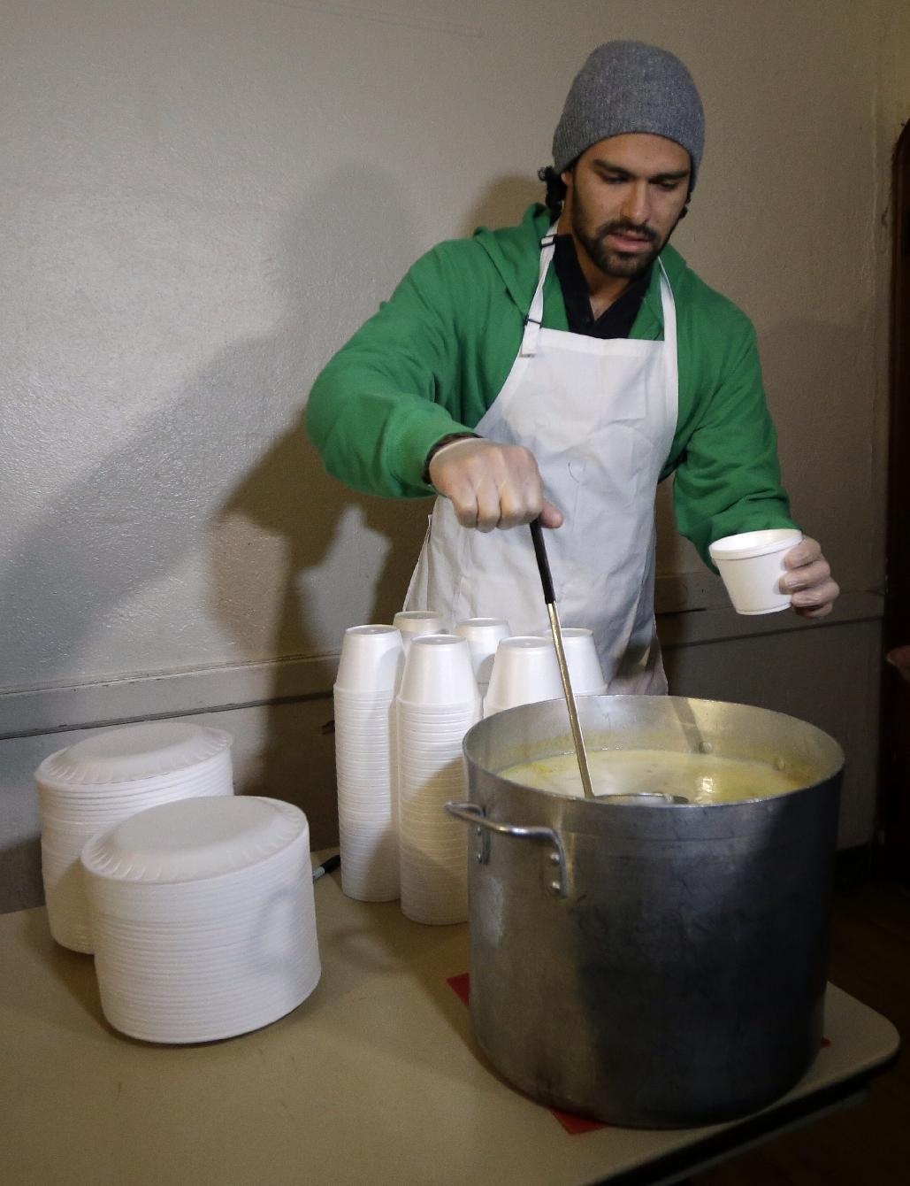 New York Jets NFL football quarterback Mark Sanchez pours a bowl of soup during a visit to the Community Soup Kitchen of Morristown as part of the team's Thanksgiving Day week celebration, Tuesday, Nov. 26, 2013, in Morristown, N.J