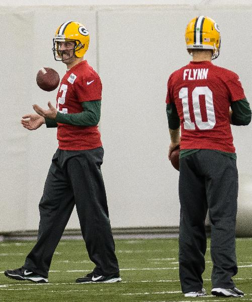 Green Bay Packers NFL football quarterback Aaron Rodgers (12) practices in Ashwaubenon, Wisc., on Tuesday, Nov. 26, 2013. At right is Packers quarterback Matt Flynn