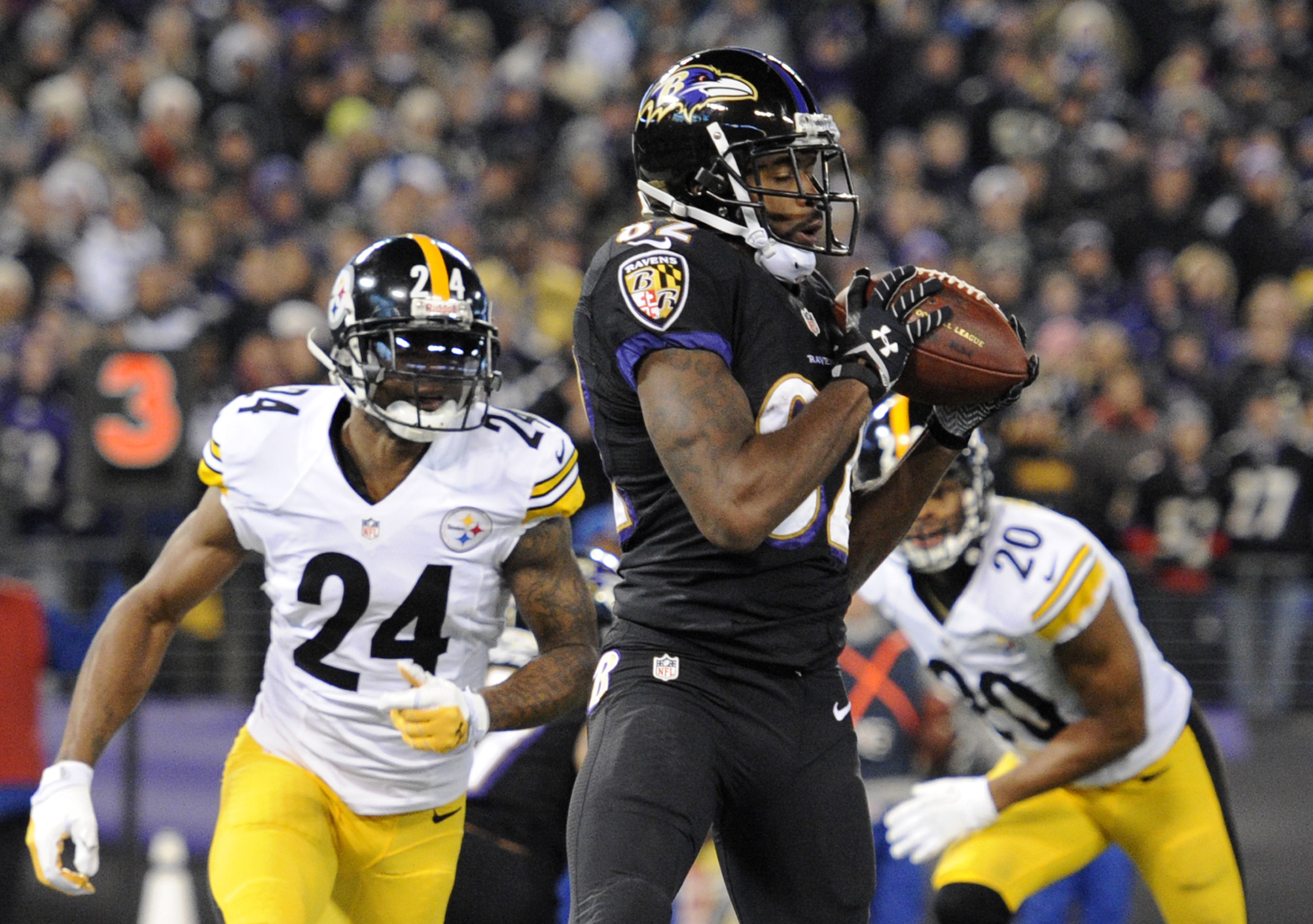 Baltimore Ravens wide receiver Torrey Smith, center, makes a touchdown catch in front of Pittsburgh Steelers cornerback Ike Taylor (24) and strong safety Will Allen in the first half of an NFL football game on Thursday, Nov. 28, 2013, in Baltimore