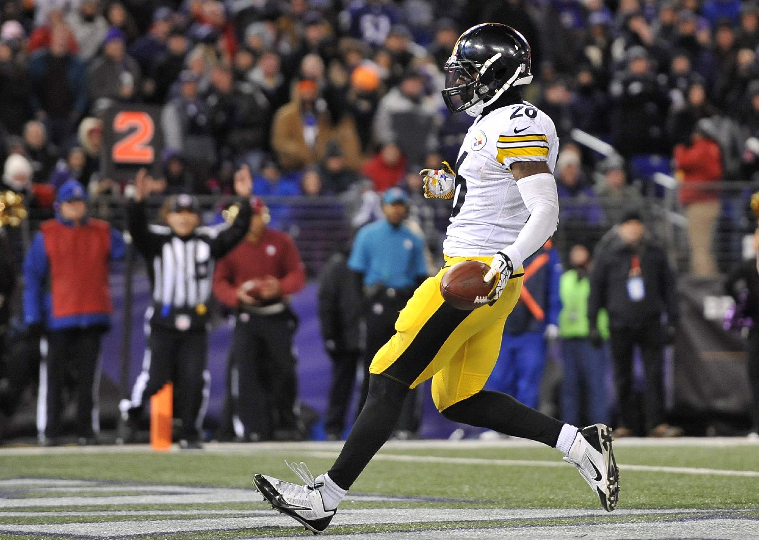 Pittsburgh Steelers running back Le'Veon Bell runs into the end zone for a touchdown in the second half of an NFL football game against the Baltimore Ravens, Thursday, Nov. 28, 2013, in Baltimore
