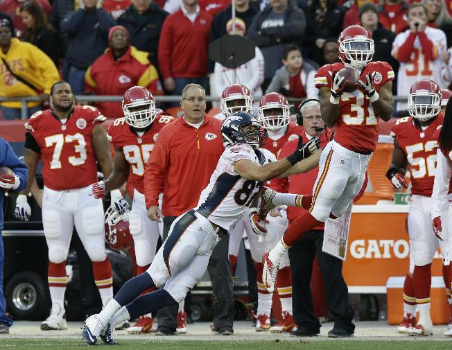 Kansas City Chiefs cornerback Marcus Cooper (31) intercepts a pass intended for Denver Broncos wide receiver Eric Decker (87) during the first half of an NFL football game, Sunday, Dec. 1, 2013, in Kansas City, Mo