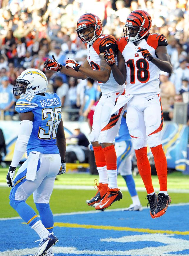 Cincinnati Bengals wide receiver A.J. Green (18) celebrates his touchdown with teammate wide receiver Marvin Jones as San Diego Chargers strong safety Marcus Gilchrist stands by at left during the second half of an NFL football game Sunday, Dec. 1, 2013, in San Diego