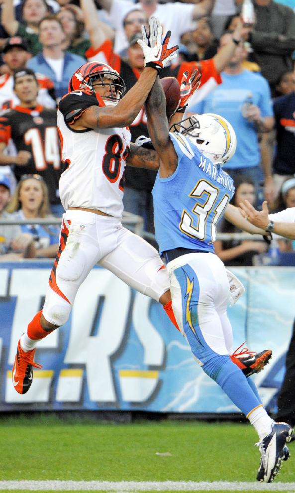 Cincinnati Bengals wide receiver Marvin Jones, left, can't make the catch as San Diego Chargers cornerback Richard Marshall defends during the second half of an NFL football game Sunday, Dec. 1, 2013, in San Diego