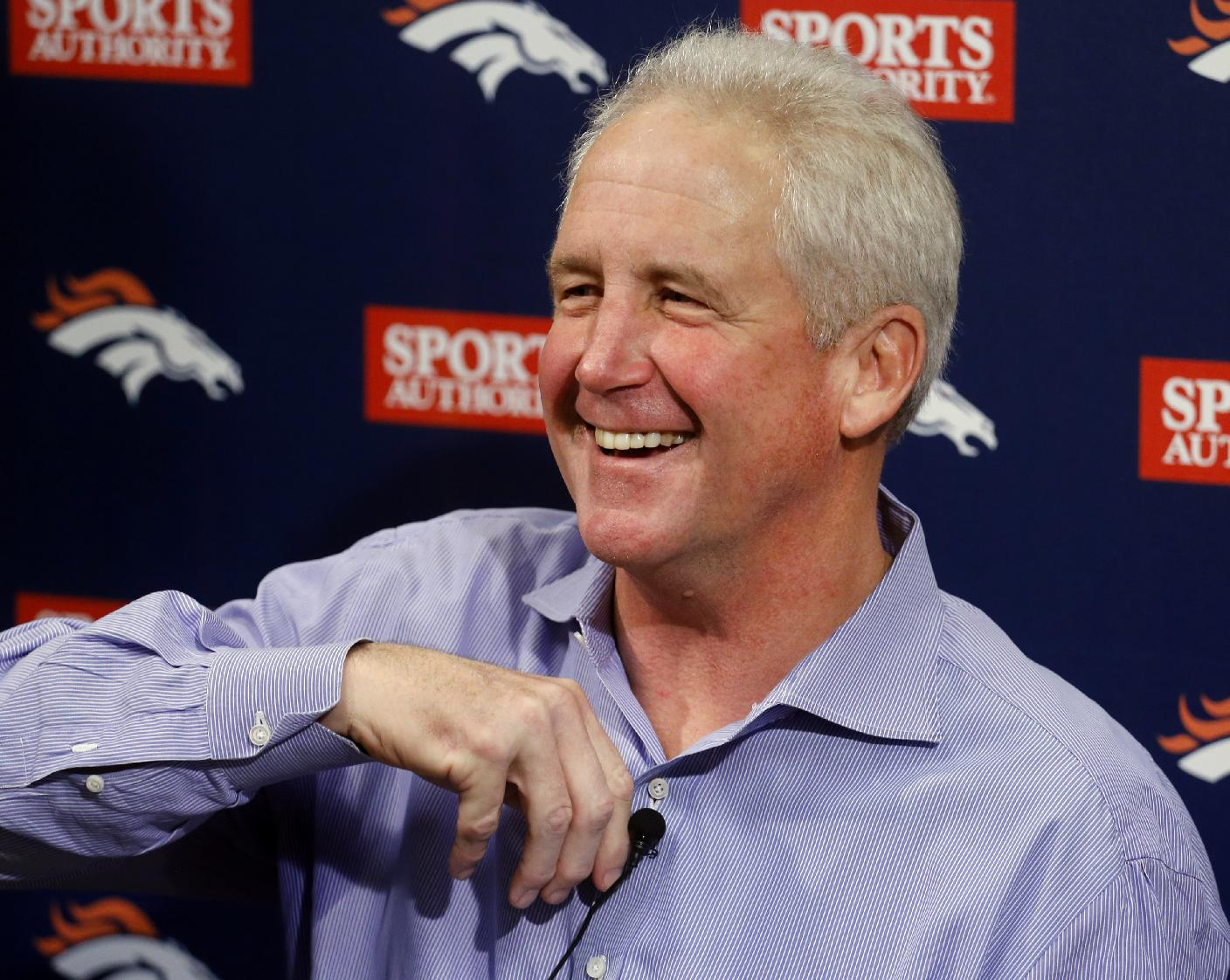 Denver Broncos head football coach John Fox smiles at the conclusion of a news conference at the NFL team's headquarters in Englewood, Colo.,  on Monday, Dec. 2, 2013. Fox returned to work on Monday for the first time since having heart surgery last month