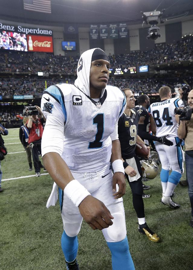 Carolina Panthers quarterback Cam Newton (1) walks off the field after an NFL football game against the Carolina Panthers in New Orleans, Sunday, Dec. 8, 2013. The Saints won 31-13