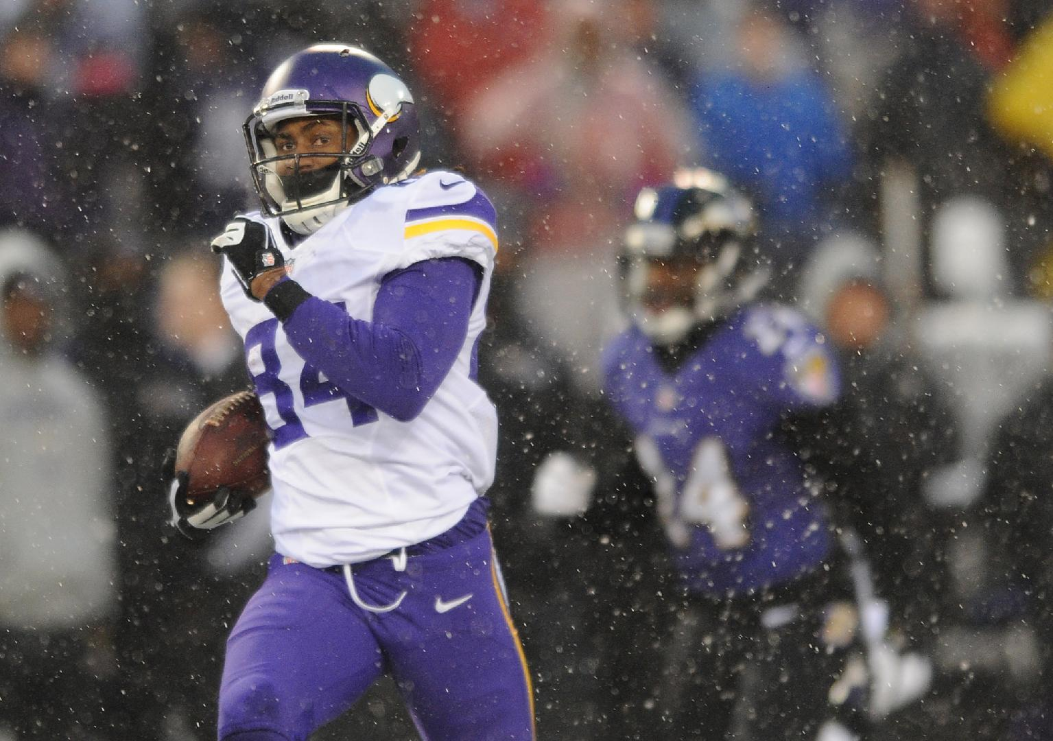 In this Dec. 8, 2013 file photo, Minnesota Vikings wide receiver Cordarrelle Patterson runs for a touchdown in the second half of an NFL football game against the Baltimore Ravens, in Baltimore. Every year in the NFL, examples abound of players in prominent roles in December who were barely noticeable in September. Minnesota's Cordarrelle Patterson, Philadelphia's Nick Foles and Tampa Bay's Bobby Rainey are a few of those