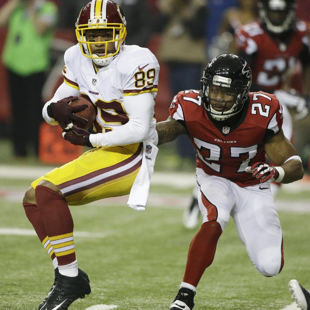 Washington Redskins wide receiver Santana Moss (89) makes the catch against Atlanta Falcons cornerback Robert McClain (27) during the first half of an NFL football game, Sunday, Dec. 15, 2013, in Atlanta