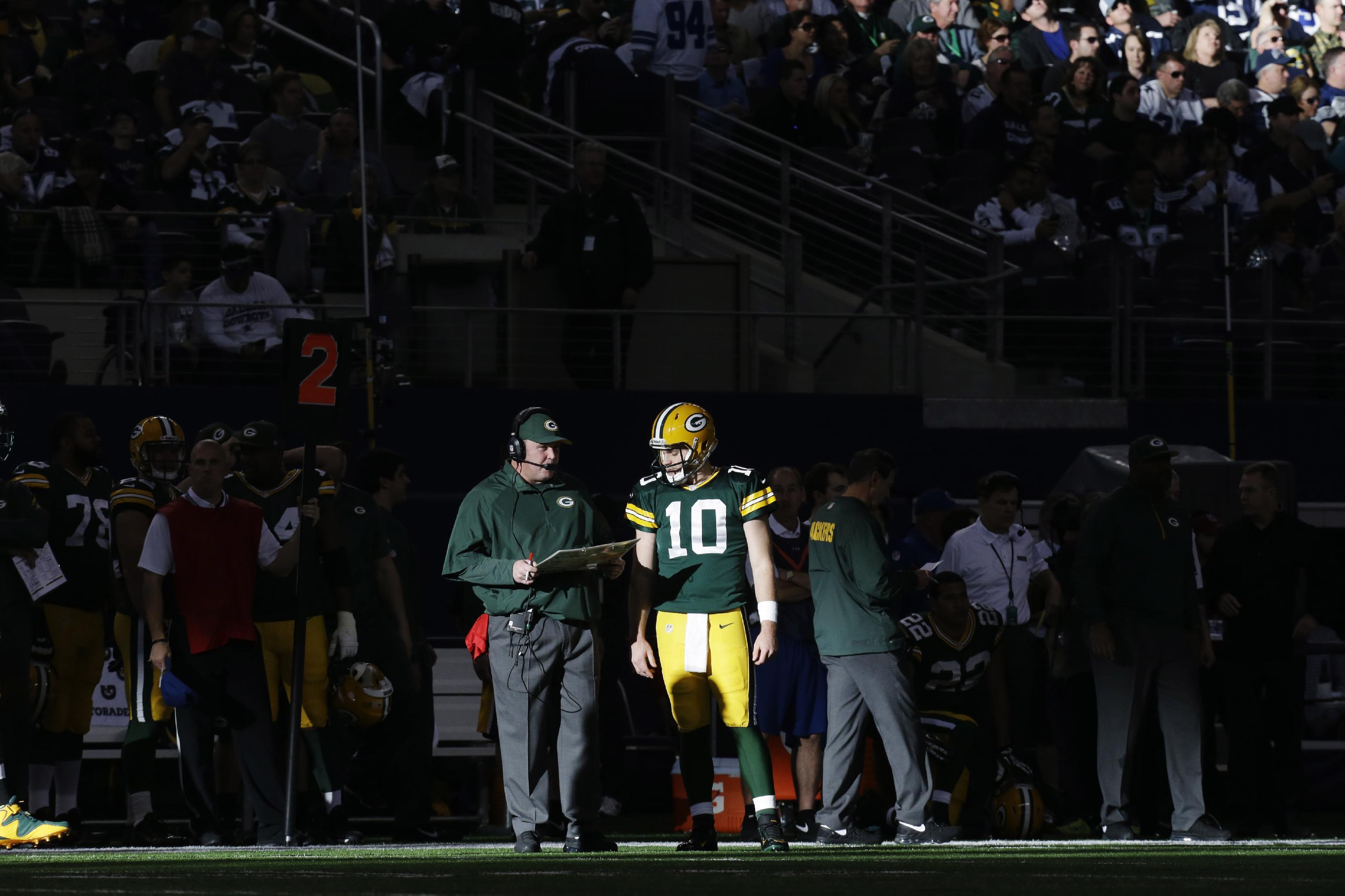 Green Bay Packers quarterback Matt Flynn (10) talks with head coach Mike McCarthy during the first half of an NFL football game against the Dallas Cowboys, Sunday, Dec. 15, 2013, in Arlington, Texas