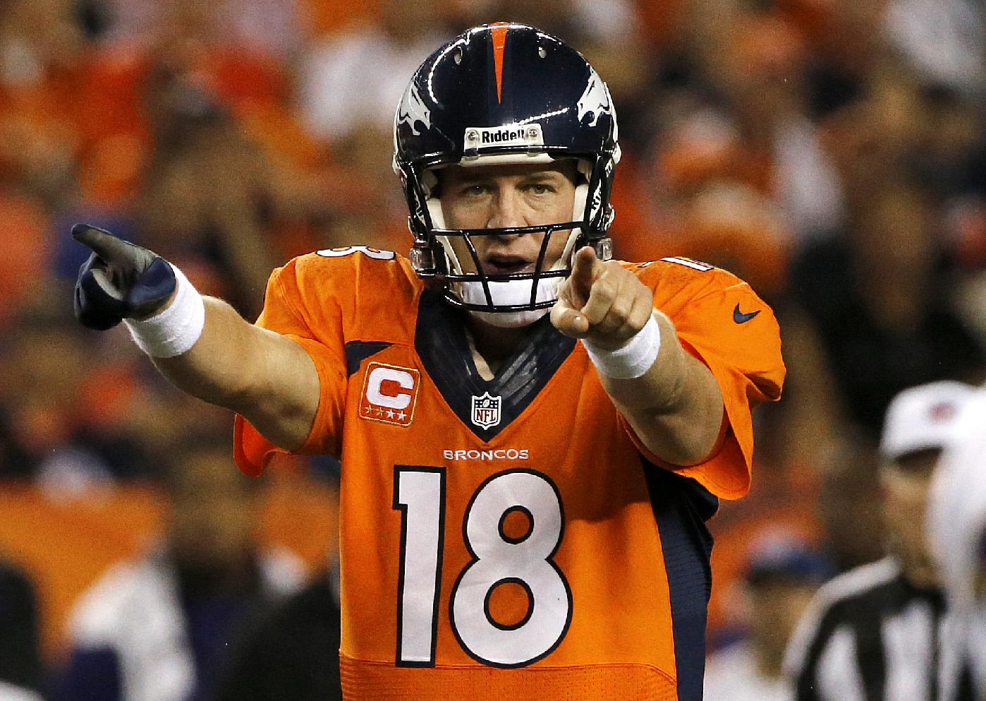 In this Sept. 5, 2013, file photo, Denver Broncos quarterback Peyton Manning (18) calls a play at the line of scrimmage during the first half of an NFL football game against the Baltimore Ravens in Denver. Manning is Sports Illustrated's Sportsman of the Year.  He is the fourth NFL quarterback to take the honor in the last nine years, following Brady in 2005, Brett Favre in 2007 and Drew Brees in 2010. LeBron James was the winner last year