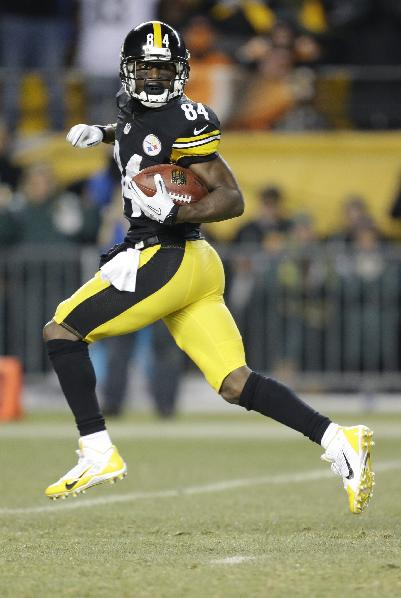 Pittsburgh Steelers wide receiver Antonio Brown (84) goes in for a touchdown in the first quarter of an NFL football game between the Pittsburgh Steelers and the Cincinnati Bengals on Sunday, Dec. 15, 2013 in Pittsburgh