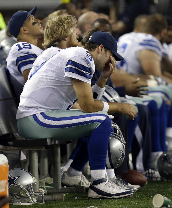 Dallas Cowboys quarterback Tony Romo sits on the bench in the final minutes of the second half of an NFL football game against the Green Bay Packers, Sunday, Dec. 15, 2013, in Arlington, Texas. Romo threw two interceptions in the game's final three minutes. The Green Bay Packers rallied from a 23-point halftime deficit to beat the Cowboys