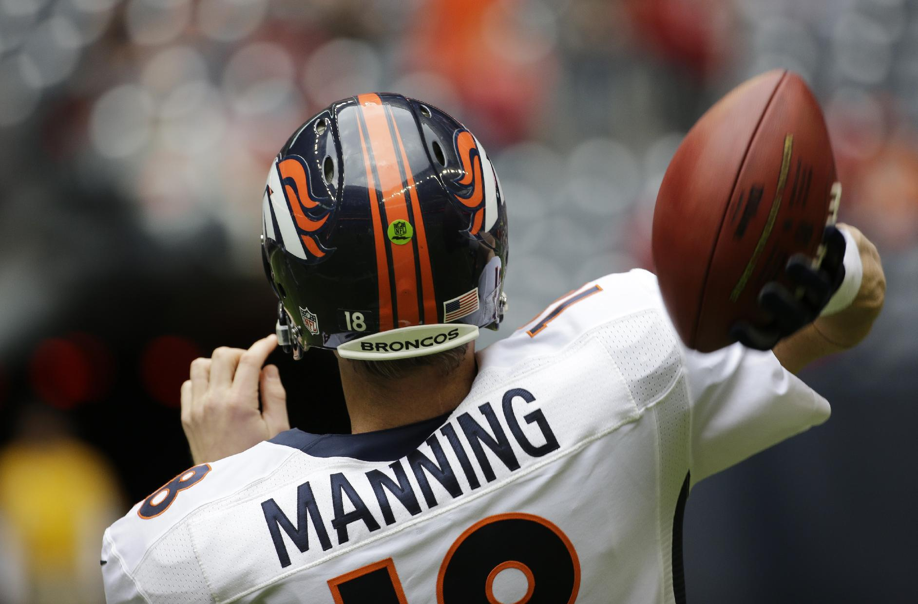 Denver Broncos' Peyton Manning throws as he prepares before an NFL football game against the Houston Texans, Sunday, Dec. 22, 2013, in Houston