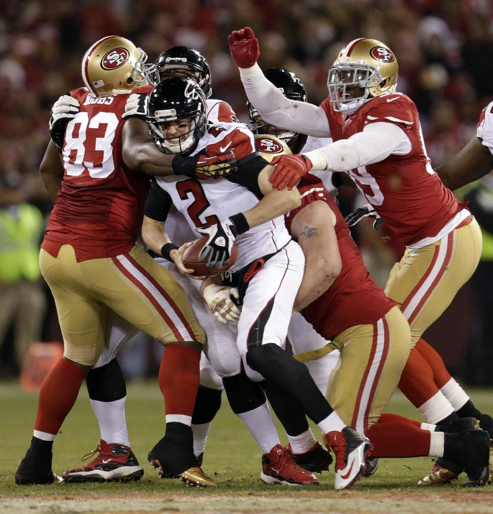 Atlanta Falcons quarterback Matt Ryan (2) is sacked by San Francisco 49ers defensive tackle Justin Smith, bottom, during the first half of an NFL football game in San Francisco, Monday, Dec. 23, 2013