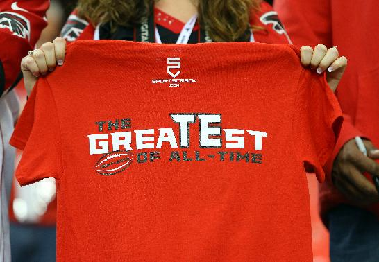 Sidney Sears, of Gainesville, Fla., holds out the back of her shirt in support of Atlanta Falcons tight end Tony Gonzalez before an NFL football game between the Falcons and Carolina Panthers on Sunday, Dec. 29, 2013, in Atlanta