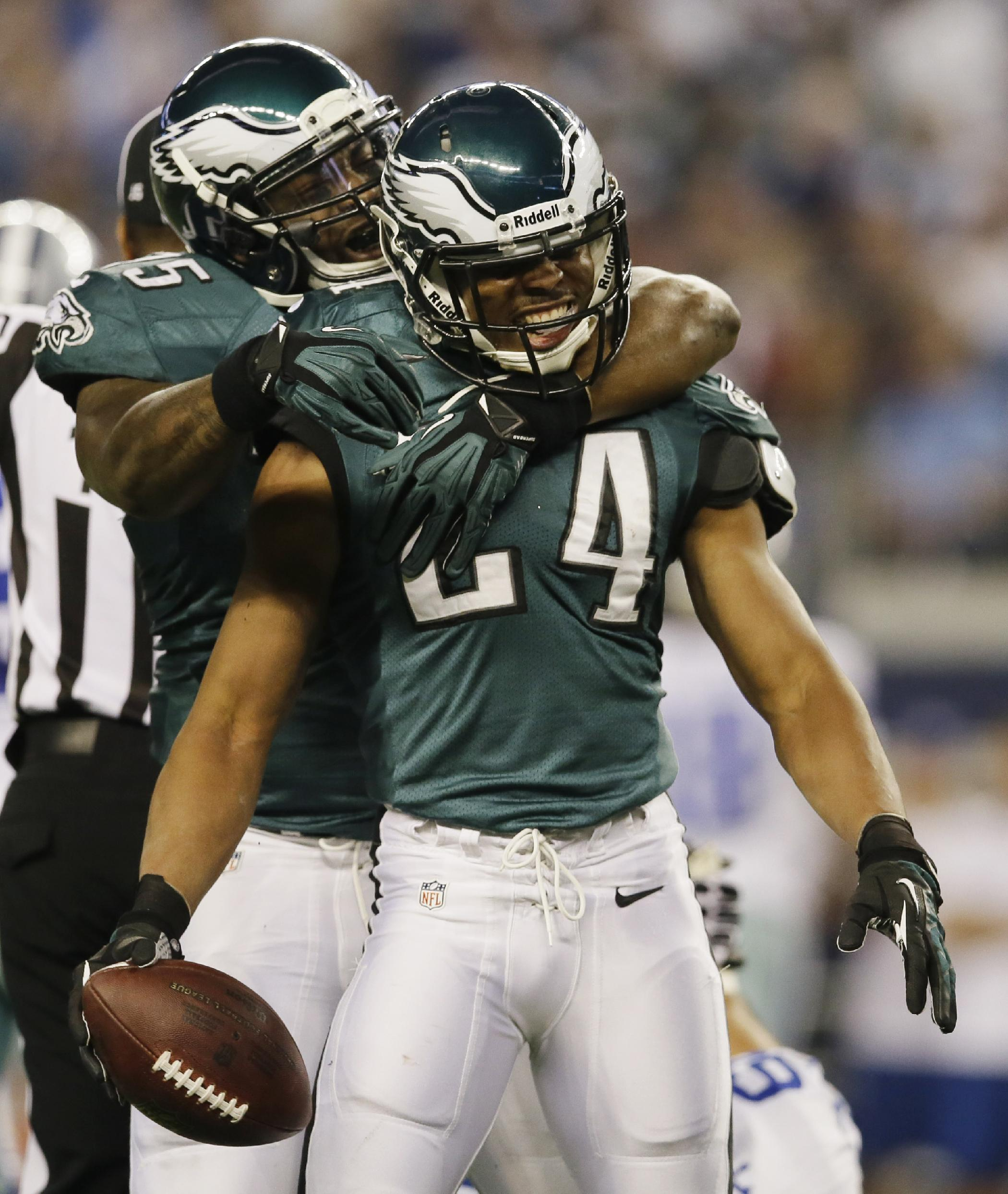 After recovering a fumble by Dallas Cowboys running back DeMarco Murray, Philadelphia Eagles cornerback Bradley Fletcher (24) celebrates with defensive end Vinny Curry during the first half of an NFL football game, Sunday, Dec. 29, 2013, in Arlington, Texas