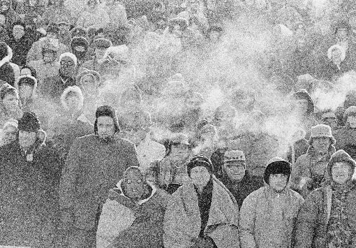 In this Dec. 31, 1967 file photo, fans watch the Green Bay Packers play the Dallas Cowboys in the NFL Championship game in Green Bay, Wisc. Comparisons to the legendary 1967 Ice Bowl are inevitable when the mercury dips below zero at Lambeau Field. But even if temperatures sink to minus 13 Sunday, Jan. 5, 2014, at the 49ers-Packers playoff game, modern technology will ensure fans are warmer than their predecessors