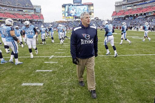 In this Dec. 15, 2013, file photo, Tennessee Titans head coach Mike Munchak watches his players warm up before an NFL football game against the Arizona Cardinals in Nashville, Tenn.  person familiar with the decision say Titans President Tommy Smith has fired  Munchak after three seasons as his head coach and 31 years combined with this franchise as a player and coach. The person spoke to The Associated Press on Saturday, Jan. 4, 2014, on the condition of anonymity because the Titans have not made an official announcement