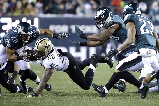 New Orleans Saints' Khiry Robinson (29) dives for extra yardage against Philadelphia Eagles' Nate Allen (29), DeMeco Ryans, second from right, and Patrick Chung (23) during the first half of an NFL wild-card playoff football game, Saturday, Jan. 4, 2014, in Philadelphia