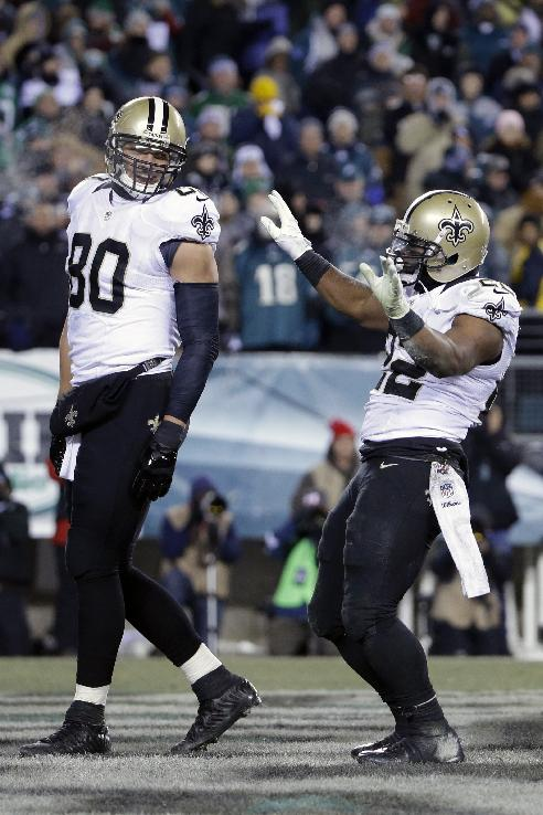 New Orleans Saints' Mark Ingram, right, celebrate with Jimmy Graham after Ingram's touchdown during the second half of an NFL wild-card playoff football game against the New Orleans Saints, Saturday, Jan. 4, 2014, in Philadelphia