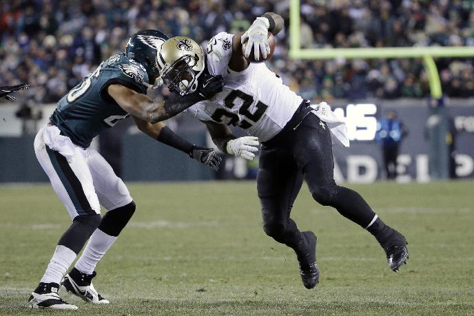 New Orleans Saints' Mark Ingram (22) tries to break free of Philadelphia Eagles' Cary Williams during the second half of an NFL wild-card playoff football game, Saturday, Jan. 4, 2014, in Philadelphia