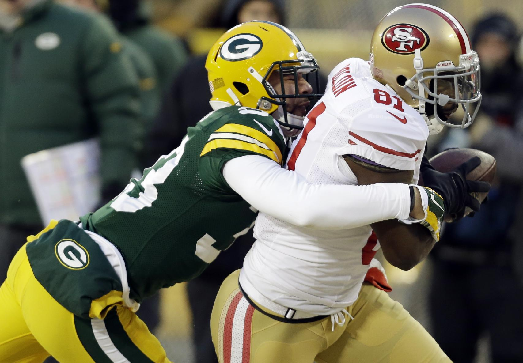 Green Bay Packers cornerback Micah Hyde (33) tackles after San Francisco 49ers wide receiver Anquan Boldin (81) makes a reception during the first half of an NFL wild-card playoff football game, Sunday, Jan. 5, 2014, in Green Bay, Wis