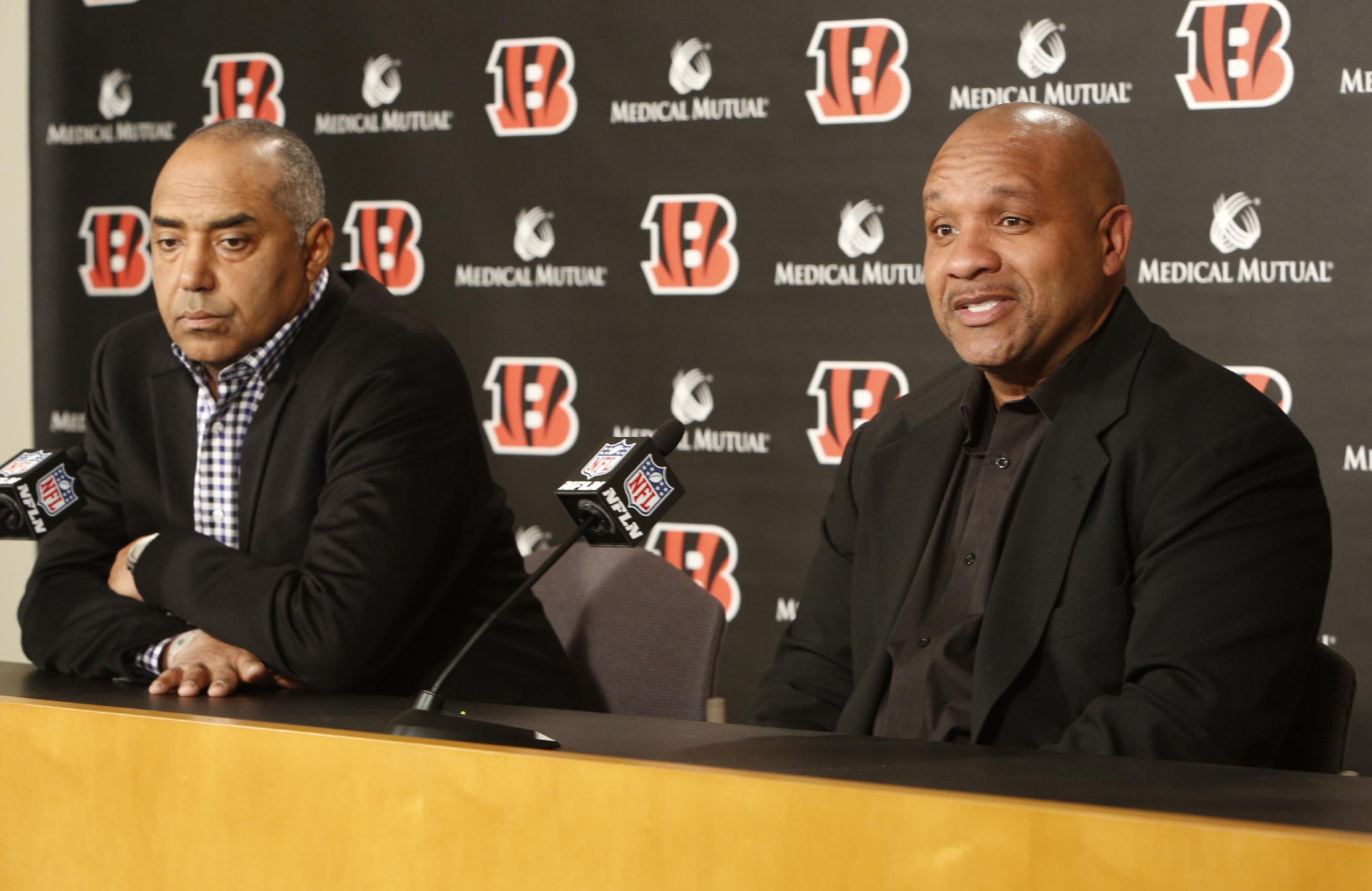 New Cincinnati Bengals offensive coordinator Hue Jackson, right, sits next to head coach Marvin Lewis, left, during a news conference, Friday, Jan. 10, 2014, in Cincinnati. Jackson replaces Jay Gruden who was named head coach of the Washington Redskins