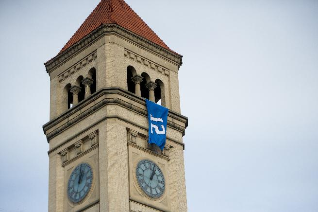 The Seahawks' 12th Man flag hangs from the Riverfront Park clock tower after Spokane Mayor David Condon unfurled it in honor of the Seattle Seahawks on Friday, Jan. 10, 2014, in Spokane, Wash. The Seahawks will host the New Orleans Saints in an NFL football second-round playoff game on Saturday
