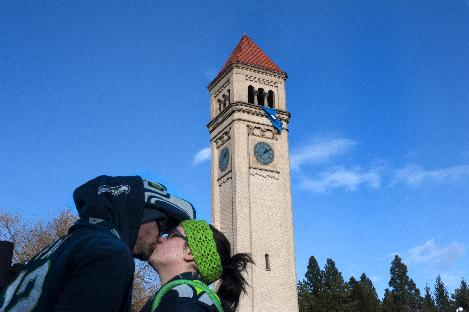 Seahawks fan Hod Zanck kisses his wife Aleah Zanck after Spokane Mayor David Condon unfurled the Seahawks' 12th Man flag at the Riverfront Park clock tower in honor of the Seattle Seahawks on Friday, Jan. 10, 2014, in Spokane, Wash. The Seahawks will host the New Orleans Saints in an NFL football second-round playoff game on Saturday