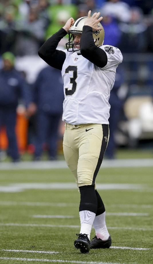 New Orleans Saints kicker Shayne Graham reacts after missing a field goal during the first quarter of an NFC divisional playoff NFL football game against the Seattle Seahawks in Seattle, Saturday, Jan. 11, 2014
