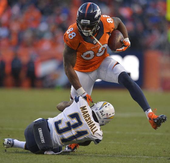 Denver Broncos wide receiver Demaryius Thomas (88) steps over San Diego Chargers cornerback Richard Marshall in the third quarter of an NFL AFC division playoff football game, Sunday, Jan. 12, 2014, in Denver