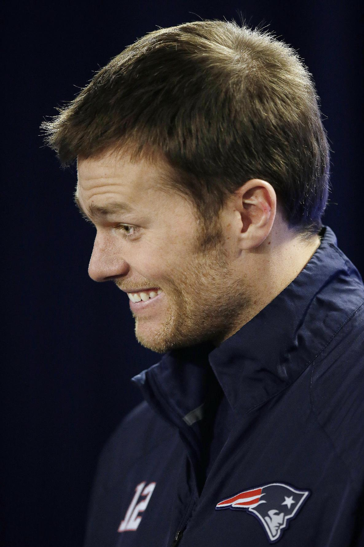 New England Patriots quarterback Tom Brady reacts to a reporter's question during an NFL football media availability at the team's training facility in Foxborough, Mass., Friday, Jan. 17, 2014. The Patriots are scheduled to play the Denver Broncos in the AFC championship game on Sunday in Denver