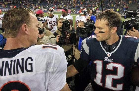 In this Oct. 7, 2012, file photo, Denver Broncos quarterback Peyton Manning, left, and New England Patriots quarterback Tom Brady, right, speak in the middle of the field after the Patriots beat the Broncos 31-21 in an NFL football game in Foxborough, Mass. The Patriots are scheduled to play the Broncos in the AFC championship game on Sunday in Denver
