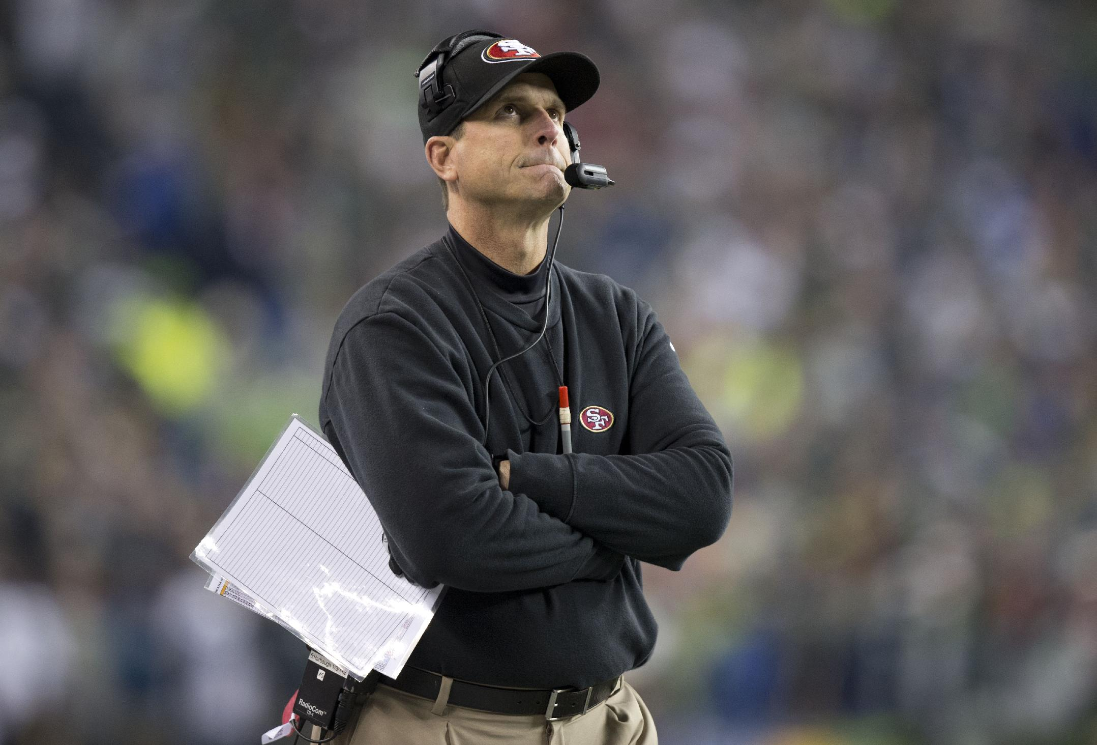 Jim Harbaugh 49ers head coach looks at the scoreboard as the Seahawks go to a 23-17 victory during the NFC championship game between the San Francisco 49ers and the Seattle Seahawks at CenturyLink Field in Seattle, Wash. on Sunday, Jan. 19, 2014