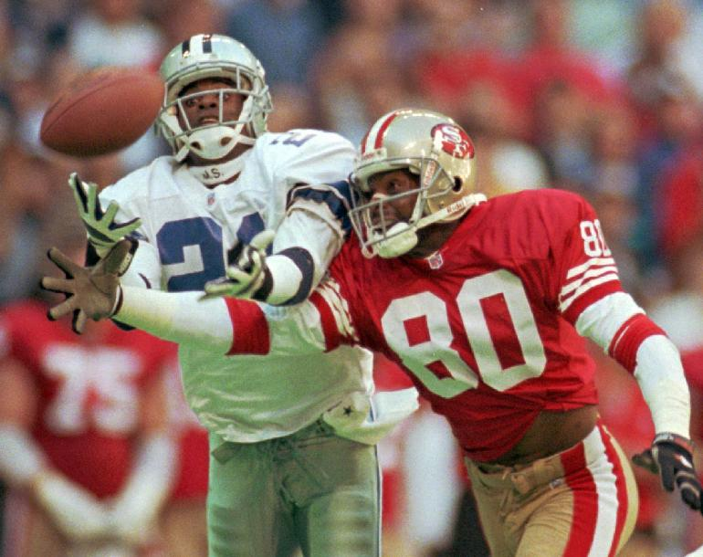 In this Nov. 12, 1995, file photo, Dallas Cowboys defender Deion Sanders (21) knocks the ball away from San Francisco 49ers receiver Jerry Rice (80) in the second quarter of an NFL football game in Irving, Texas. The Rice-Sanders rivalry is just one of several moves the NFL is using to try to rekindle interest in the Pro Bowl, set for Sunday in Hawaii. The NFL greats Deion will start the process of selecting Pro Bowl teams in the All-Star game's new format in which the two conferences no longer play each other