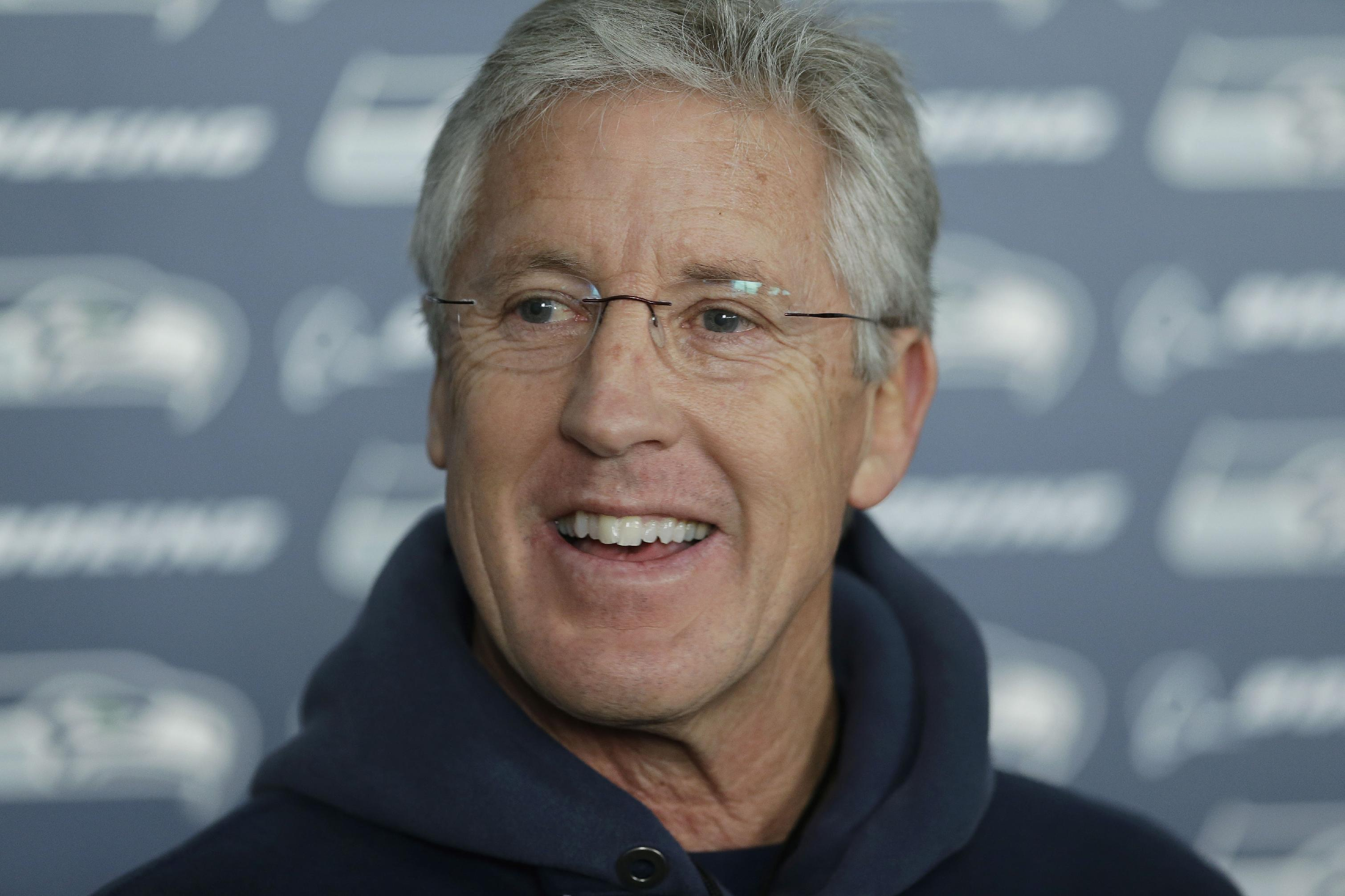 Seattle Seahawks head coach Pete Carroll talks to reporters after NFL football practice, Friday, Jan. 24, 2014, in Renton, Wash. The Seahawks will play the Denver Broncos Feb. 2, 2014 in the Super Bowl