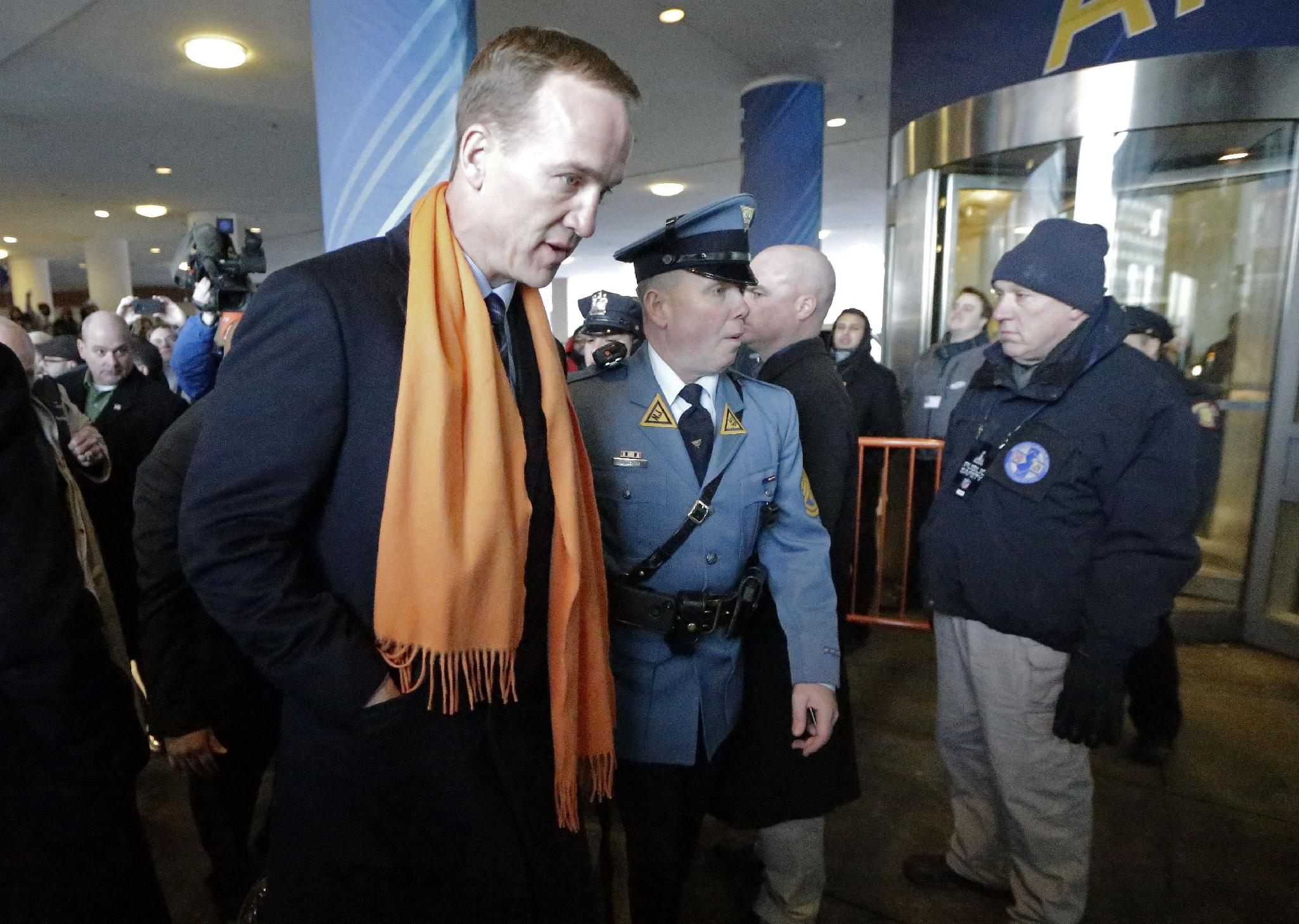 Denver Broncos quarterback Peyton Manning is escorted to the team hotel Sunday, Jan. 26, 2014, in Jersey City, N.J. The Broncos are scheduled to play the Seattle Seahawks in the NFL Super Bowl XLVIII football game Sunday, Feb. 2, in East Rutherford, N.J