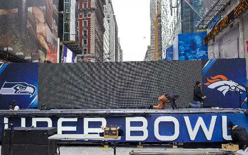 A stage structure with the logos of the Seattle Seahawks and the Denver Broncos, comes together in New York's Times Square, Monday, Jan. 27, 2014. Up to 13 blocks of Broadway in the heart of Manhattan will close to traffic for four days so the NFL can host a Super Bowl festival called Super Bowl Boulevard according to the NFL. The Broncos are scheduled to play the Seahawks in the NFL Super Bowl XLVIII football game Sunday, Feb. 2, in East Rutherford, N.J