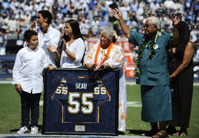 Family members of former Chargers linebacker Junior Seau attend a ceremony to retire Seau's No. 55 jersey before the Chargers face the Tennessee Titans in an NFL football game on Sunday, Sept. 16, 2012, in San Diego. The Chargers retired the No. 55 jersey worn by Junior Seau during a pregame ceremony