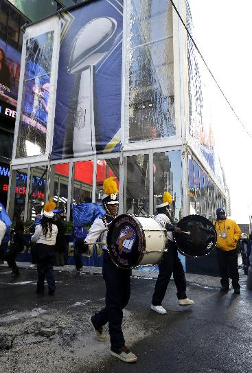 A drum line performs in front of a tent where the Vince Lombardi Trophy will be held during Super Bowl Boulevard Wednesday, Jan. 29, 2014, in New York. The Seattle Seahawks are scheduled to play the Denver Broncos in the NFL Super Bowl XLVIII football game on Sunday, Feb. 2, in East Rutherford, N.J