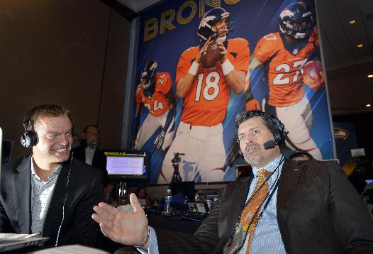 Former Denver Broncos offensive lineman and ESPN analyst Mark Schlereth talks  with Brock Huard, Host of ESPN 710 Radio Seattle on NFL Radio Row Wednesday, Jan. 29, 2014, in New York