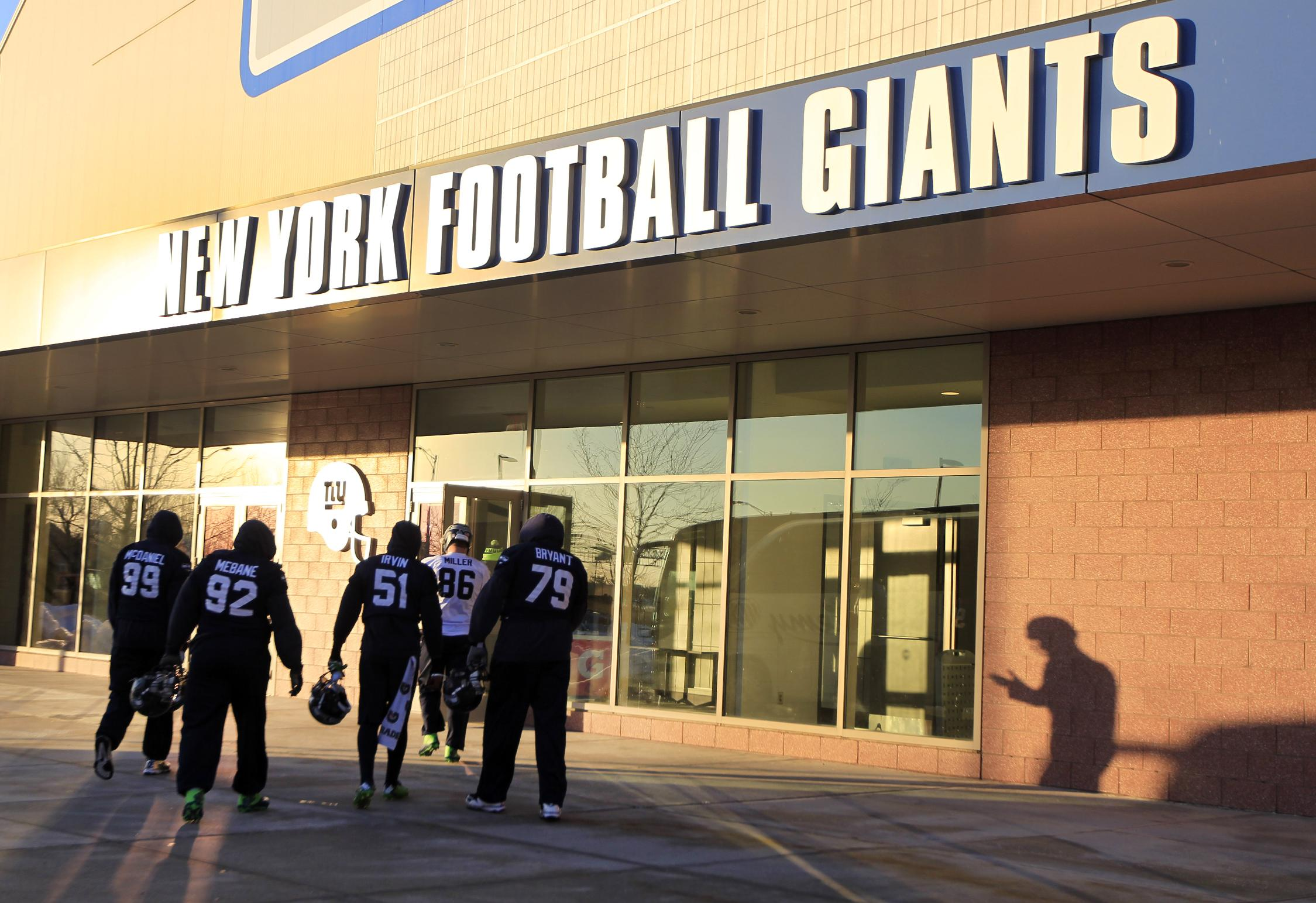 Members of the Seattle Seahawks head to the New York Giants indoor facility for NFL football practice Thursday, Jan. 30, 2014, in East Rutherford, N.J. The Seahawks and the Denver Broncos are scheduled to play in the Super Bowl XLVIII football game Sunday, Feb. 2, 2014. (AP Photo)