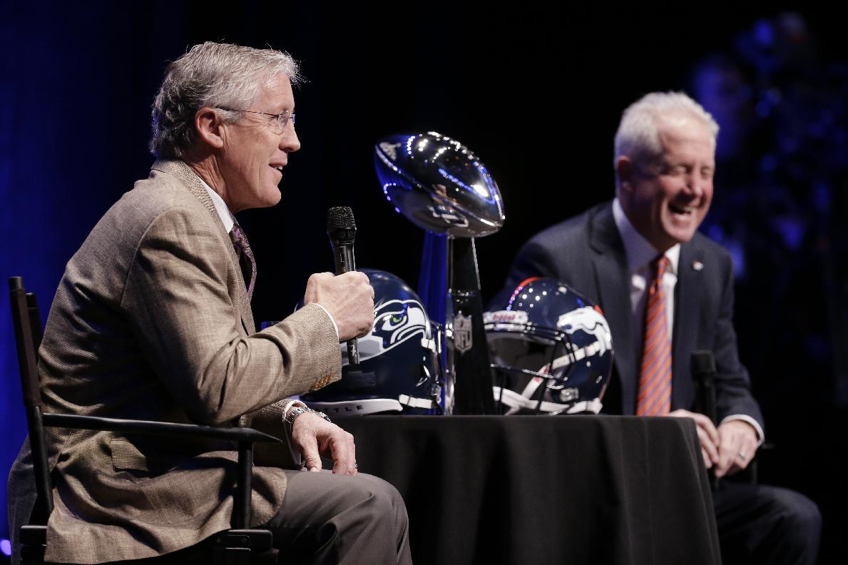 Seattle Seahawks head coach Pete Carroll, left, and Denver Broncos head coach John Fox speak at a news conference Friday, Jan. 31, 2014, in New York. The Seahawks and the Broncos are scheduled to play in the NFL Super Bowl XLVIII football game on Sunday, Feb. 2, at MetLife Stadium in East Rutherford, N.J