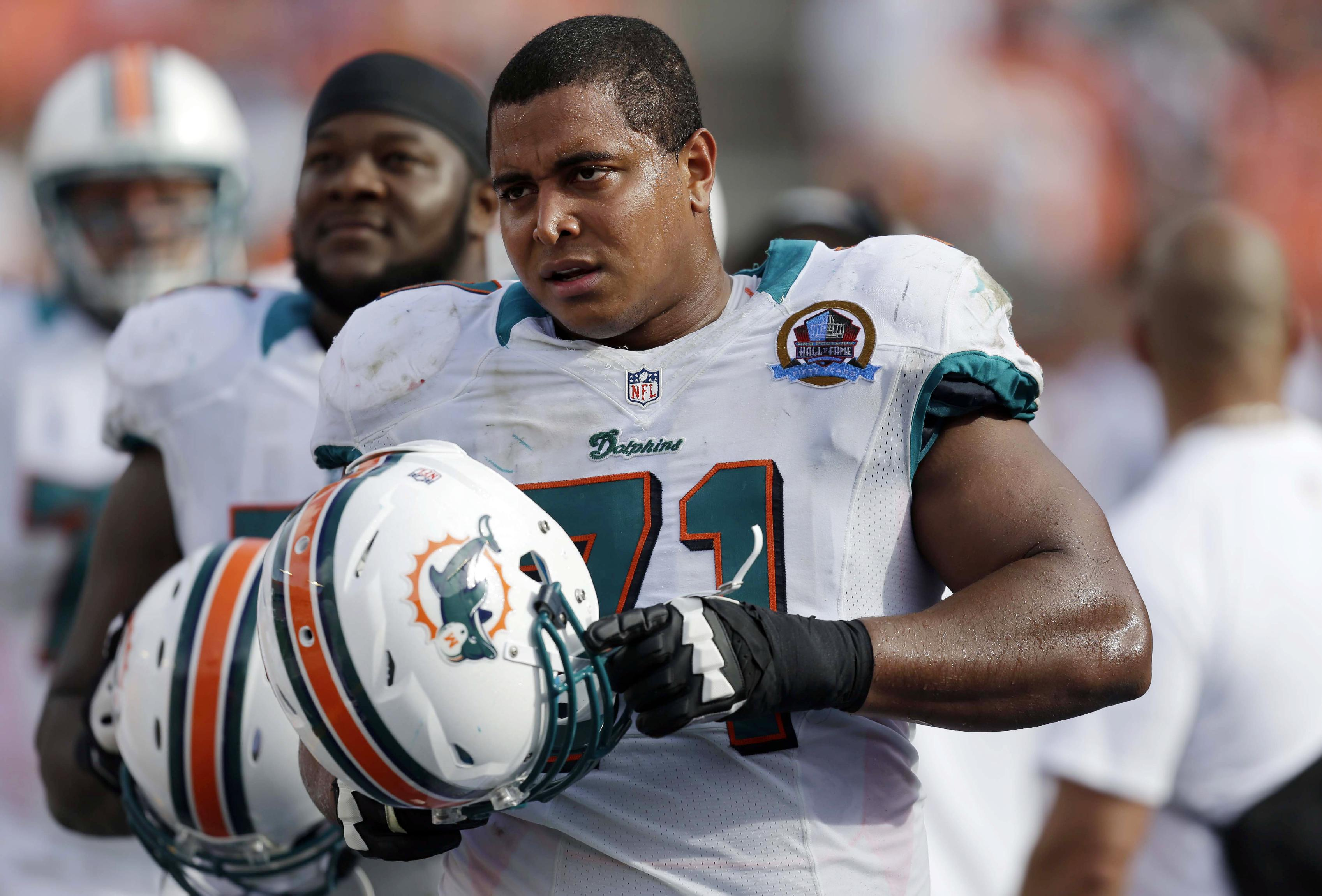 In this Dec. 16, 2012 file photo, Miami Dolphins tackle Jonathan Martin (71) watches from the sidelines during the second half of an NFL football game against the Jacksonville Jaguars, in Miami. Martin was subjected to