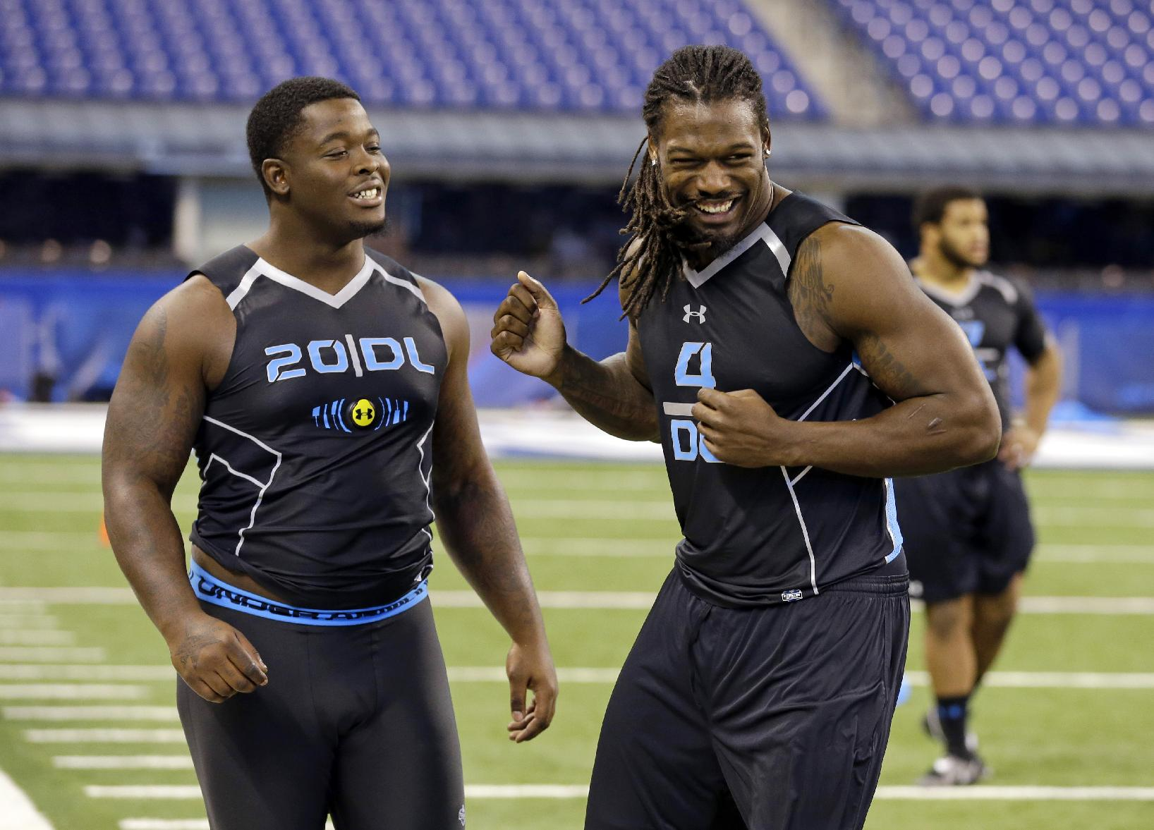 South Carolina defensive lineman Jadeveon Clowney, left, jokes with Florida State defensive lineman Timmy Jernigan during drills at the NFL football scouting combine in Indianapolis, Monday, Feb. 24, 2014