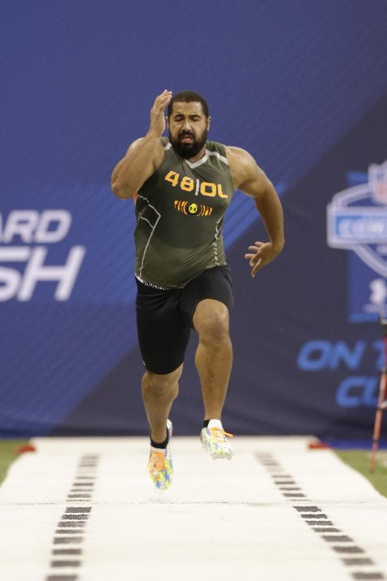 In this Feb. 22, 2014 file photo, Penn State offensive lineman John Urschel runs the 40-yard dash at the NFL football scouting combine in Indianapolis. The most exciting thing about finishing the combine is that I am no longer training like a track athlete. I am once again a football player, and now am focused on doing all I can to ensure that I am prepared for my pro day